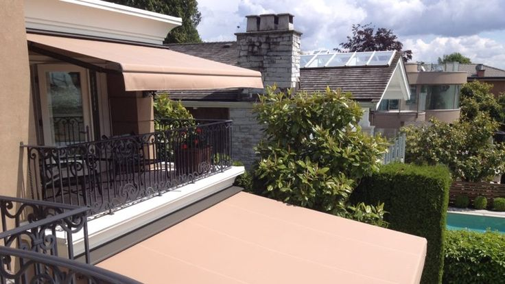 The Retractable Awnings Are Perfectly Tensioned To Withstand Wind On This West Vancouver Home