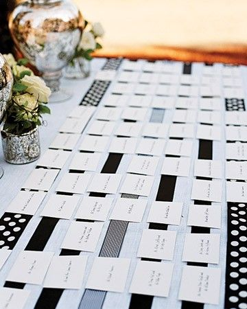 Simple black-and-white seating cards are aligned on retro-inspired ribbons.