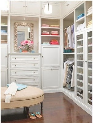 Now THIS is a closet...drawers and hanging, and NO cheap boob lights.  Storage all the way to the top. Pretty