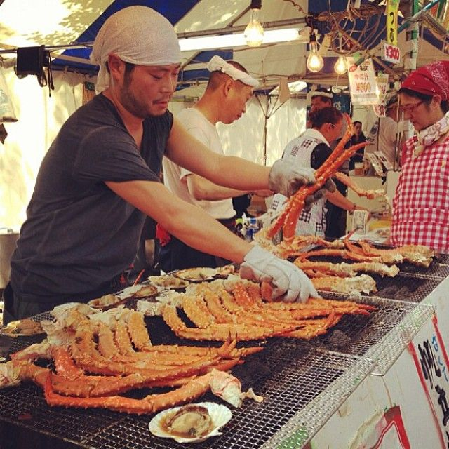 Snow crab legs and scallops on the grill at the Hokkaido Fair in Tokyo