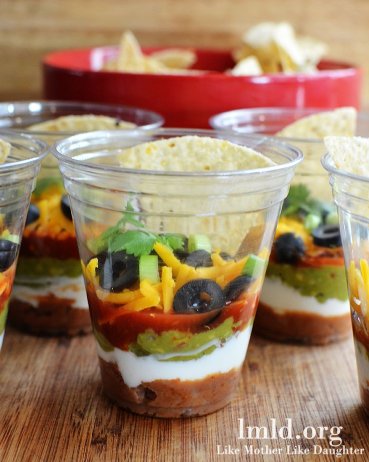 Thes 7 layer dip cups are perfect for a party! Everyone gets their own and you don't have to worry about double dipping! #lmldfood #summerparty