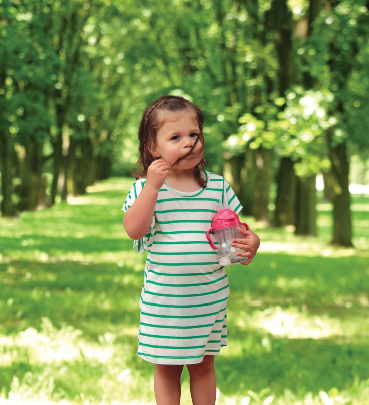 Stripy green dress in garden holding raspberry sippy cup