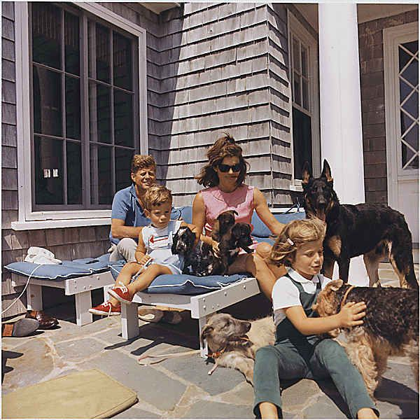 Playing with the family dogs at the Kennedy compound in Hyannisport.