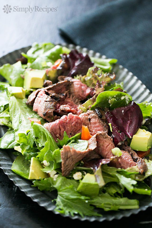 Steak Salad ~ Quick and easy steak salad with thin slices of steak served over arugula and lettuce greens, goat cheese, scallions, avocado, and bell pepper.  Serve with lemon vinaigrette. ~ SimplyRecipes.com