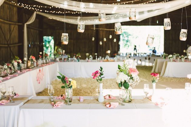 So many gorgeous details at this barn wedding! Hanging mason jars dipped in gold glitter anyone? / Brett and Jessica Photography