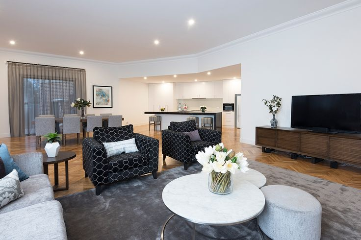 Charcoal, silver and blue open plan living design.