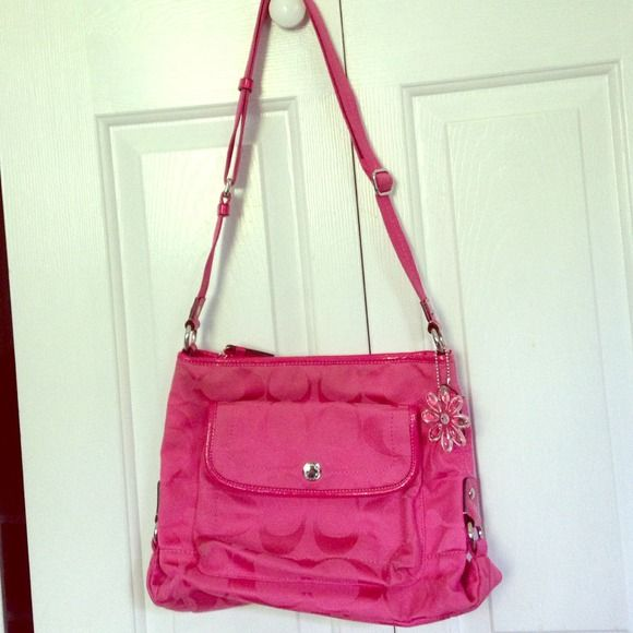 Authentic Pink Coach duffle bag  This fun Coach adjustable strap duffle bag is amazing! It has lots of great pockets, featuring Coachs staple cell phone pocket and mirror pocket along with zippered pocket inside, along with front flap and large back side pocket! *very trendy* Coach Bags