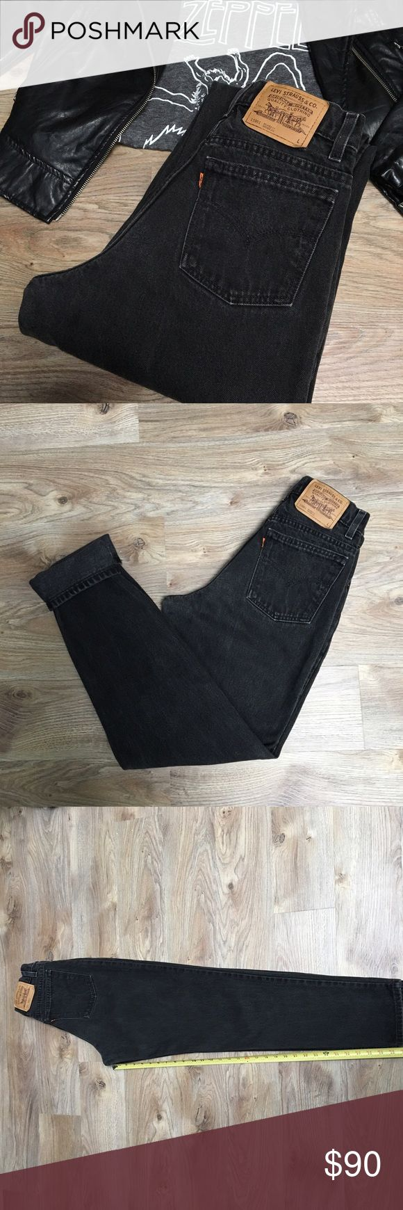 High waisted vintage black Levi's High waited black vintage Levi's tapered orange tab! Measurements laying flat: waist 14 hips 19 inseam 31 leg opening 6 1/2 Levi's Jeans Straight Leg