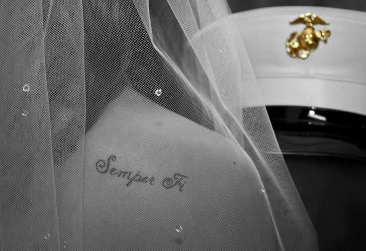 Had the privilege of shooting a wedding for a young marine.  His new bride decided to get tattooed in his honor.