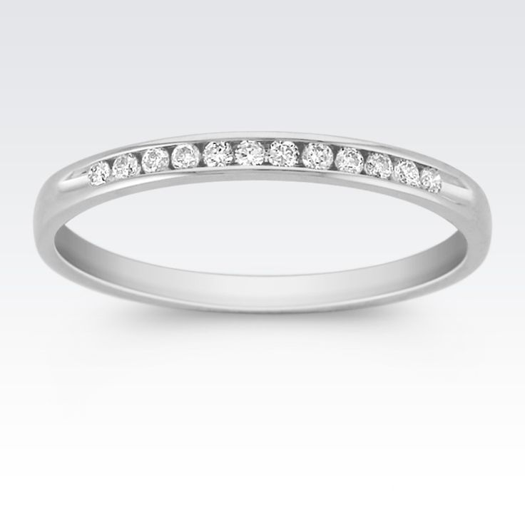This quality 14 karat white gold 2mm wide band sparkles with twelve round channel-set diamonds, at approximately .10 carat total weight.  Each stone has been hand-select for consistent fire and brilliance.