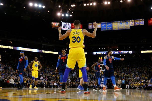 Stephen Curry of the Golden State Warriors looks on during a break in play against the Oklahoma City Thunder at ORACLE Arena on February 24 2018 in...