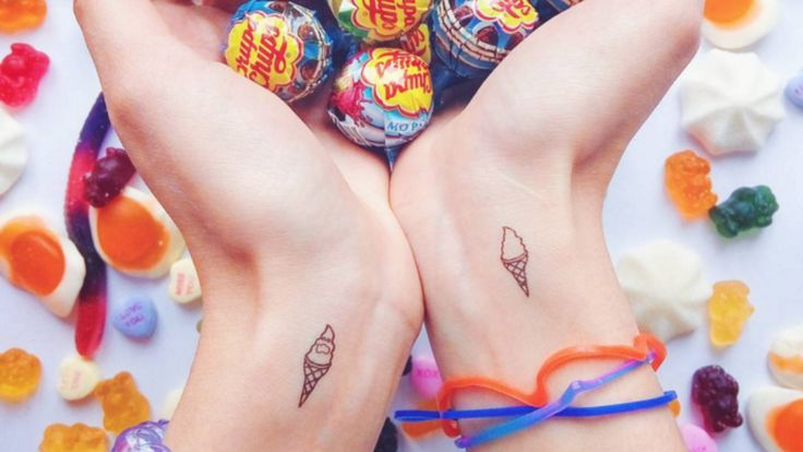 http://www.revelist.com/arts/best-tiny-tattoo-designs/1368/These little ice cream cones are giving me a cavity and I'm so OK with that./15