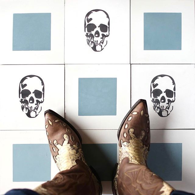 """it's your space... if you love it, do it! snakeskin cowboy boots and all. #cletile #tiletheworld ✨ tile featured is """"skull"""" (currently in stock) from the shakespeare collection and """"boxed in"""" (special order) cement tile."""