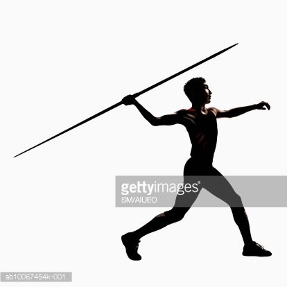 Silhouette of male athlete throwing javelin, side view