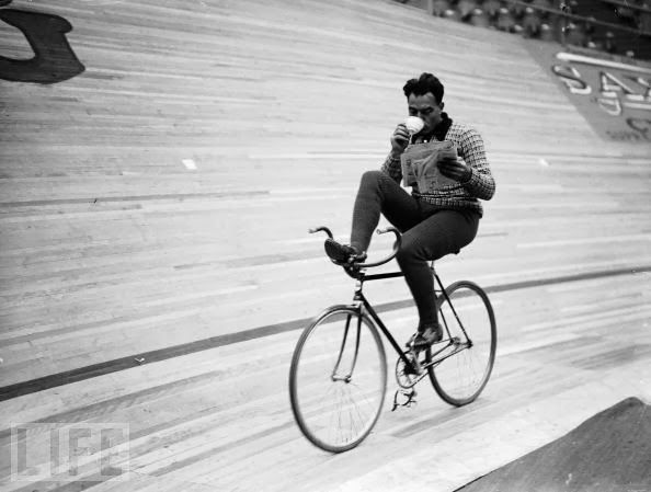 Dutch cyclist Piet van Kempen takes a break while riding a six day cycling event at Wembley, 1936.