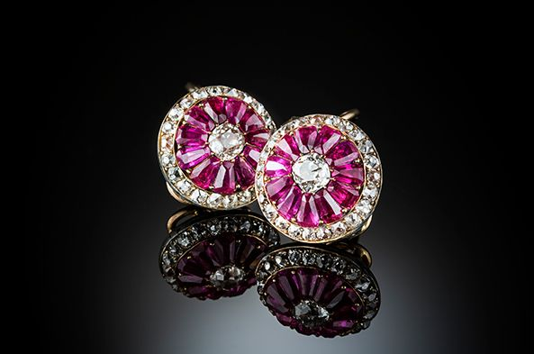 Antique earrings with modified emerald cut rubies(est. 4.4 cts.), old European cut diamond centres, old cut diamond border (est. total 3.53 ct.). Later clip fittings.