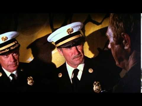 ■ The Towering Inferno ■ is a 1974 disaster film by John Guillermin and Irwin Allen and starring Steve McQueen, Paul Newman and William Holden. The Towering Inferno was a huge success and budget of 14 million was almost 10 times recouped.