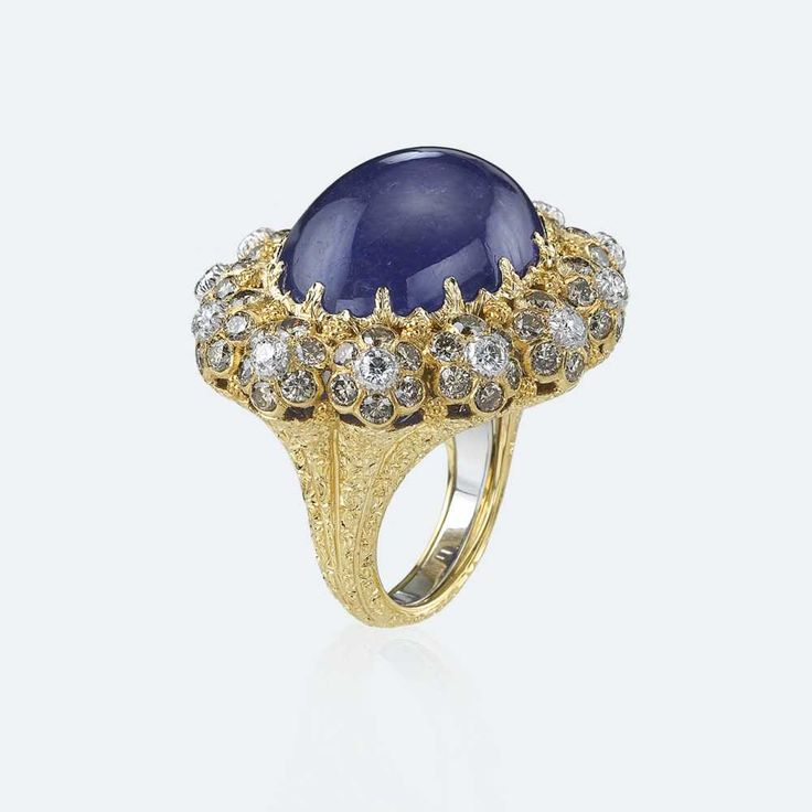 Cocktail ring with tanzanite, enhanced by a mounting with a bouquet of diamonds on yellow gold. A stone of profound spiritual significance, in the purple variety it is particularly associated with the highest degree of knowledge and wisdom. A symbol of mysticism and spirituality, the tanzanite inspires us to grasp the deepest meaning of the world around us. Http://www.facebook.com/diamonddreamfinejewelers http://www.twitter.com/diamond_dream_ http://www.instagram.com/diamonddreamjewelers