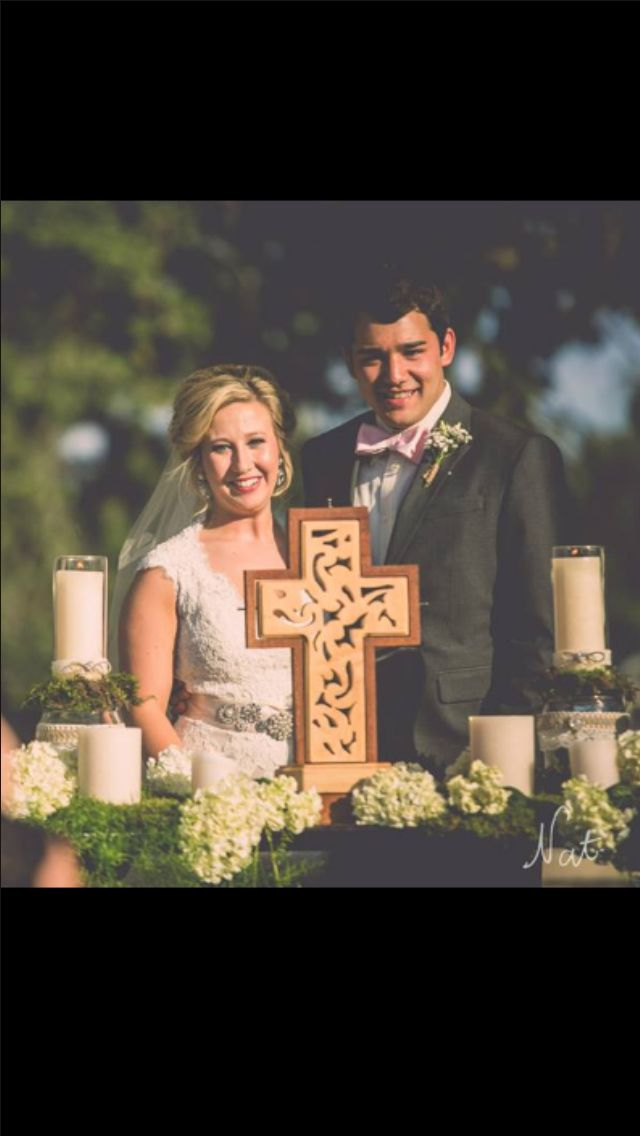 The Unity Cross was created by the bride's father and used during the ceremony. The bottom of the cross opens up to hold the wedding vows for years to come.