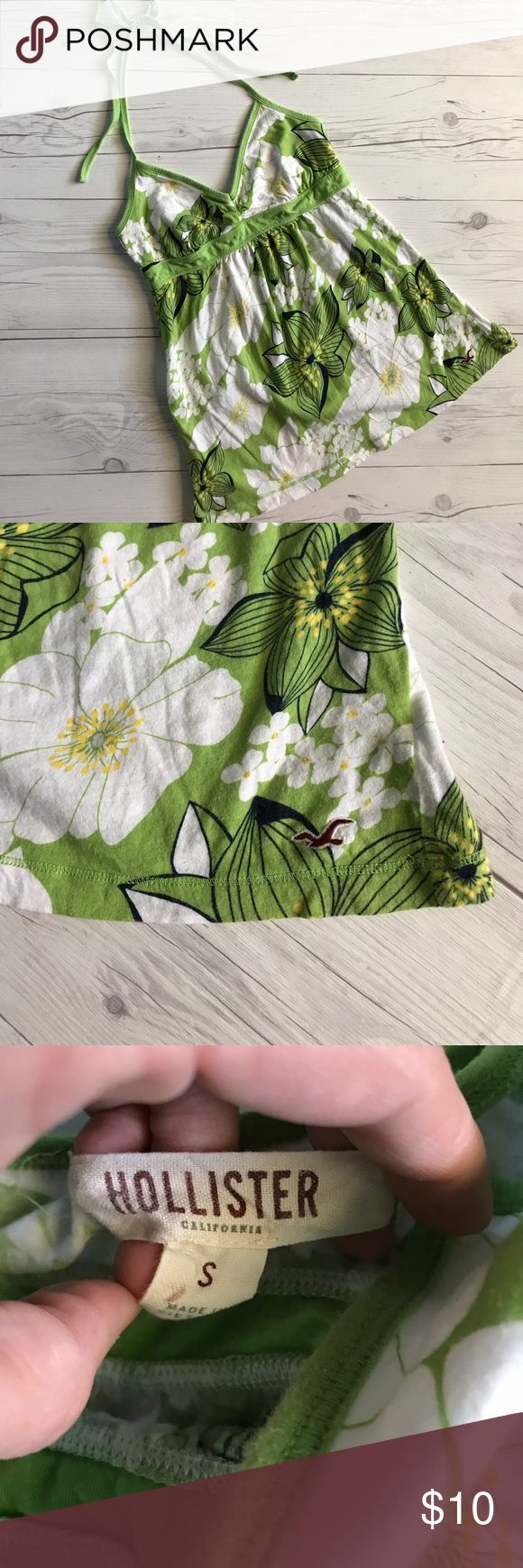 Hollister top Green and white floral cotton halter top by Hollister. Size small. Excellent condition no rips or stains. ALL ITEMS ARE BUY 2 GET 1 FREE! Hollister Tops