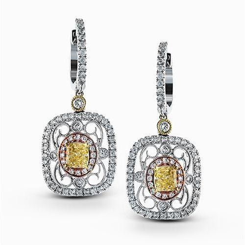 Featuring delicate vintage-inspired styling, these three-tone dangle earrings ar...