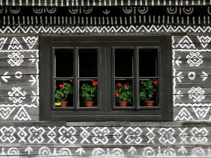 slovakia207: Slovakia - Cicmany village: folk architecture reserve - window with flower pots - Zilina district - photo by J.Kaman - (c) Travel-Images.com - Stock Photography agency - Image Bank