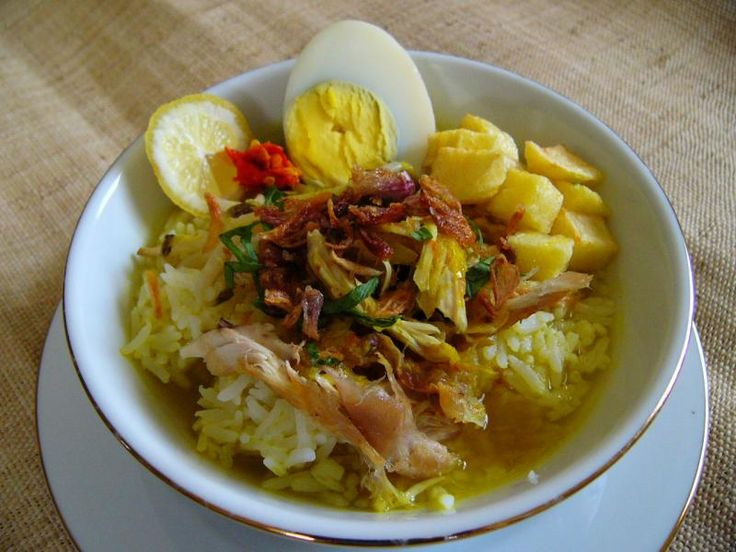 Soto is a yellow tasty chicken soup with a strong taste of turmeric and garlic. it served hot with boiled egg, bean sprouts, shredded chicken, glass noodles, chopped celery leaves, golden fried shallots, fried potato sticks, lemon grass and fried onion. Yummy!