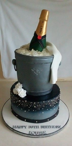 A champagne bottle and ice bucket 30th birthday cake. With a baileys sponge cake and baileys buttercream