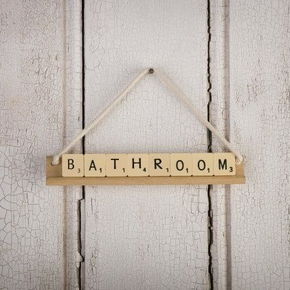 What a great DIY idea!  I just picked up an old Scrabble game at a garage sale to use for crafts supplies - love this one for laundry room, kids room....