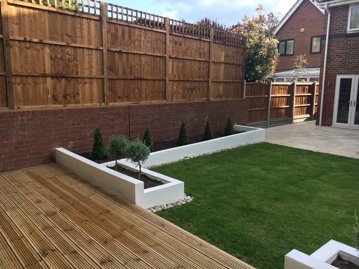 Modern garden design white raised beds urban low maintenance landscaping fencing grass lawn