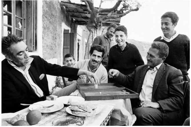 Anthony Quinn with locals during filming Zorba the Greek (1964)