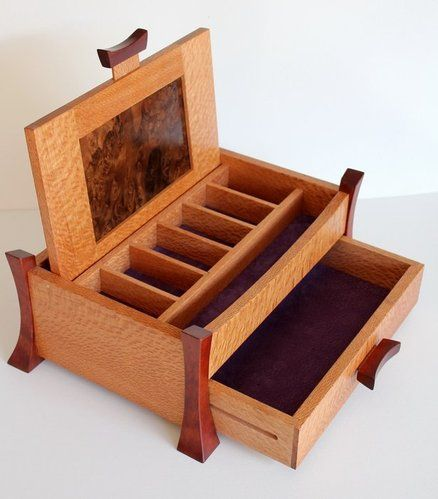 Asian style box from silky oak, rosewood and walnut. The box measures 305mm x 197 mm x 120 mm high.