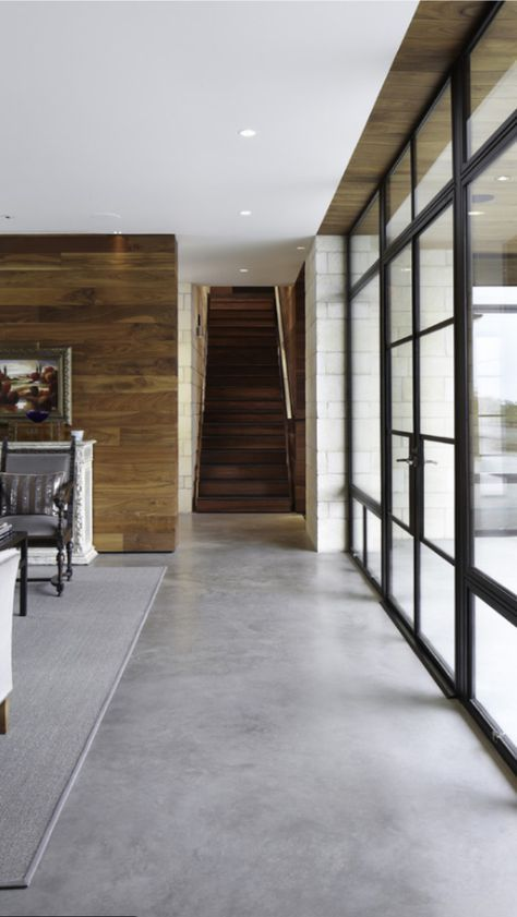 Concrete Floors! Love the contrast of the wood and the concrete floor….. step down to concrete floors