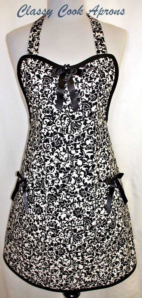 Apron in dazzling designer floral damask screen print fabric entitled Midnight Garden. For a touch of panache, we added Onyx binding, satin bows on both lined pockets and a sequined ribbon rosette on the satin bow at center bib. Glamour Girl Gorgeous!!