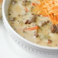 Cheeseburger Soup:  ~  Award Winning! ~~ Ground Beef + onion + carrots + celery + basil + parsley + butter + chicken broth + potatoes + velvetta cheese + flour + milk + sour cream.