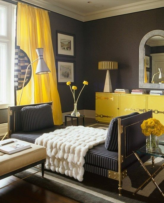 Yellow & gray living room design with charcoal gray walls paint color, canary yellow silk curtains, glossy yellow lacquer cabinet with brass hardware, arch mirror, navy blue striped chaise lounge, nickel faux bamboo glass-top end tables and gray rug.  tags