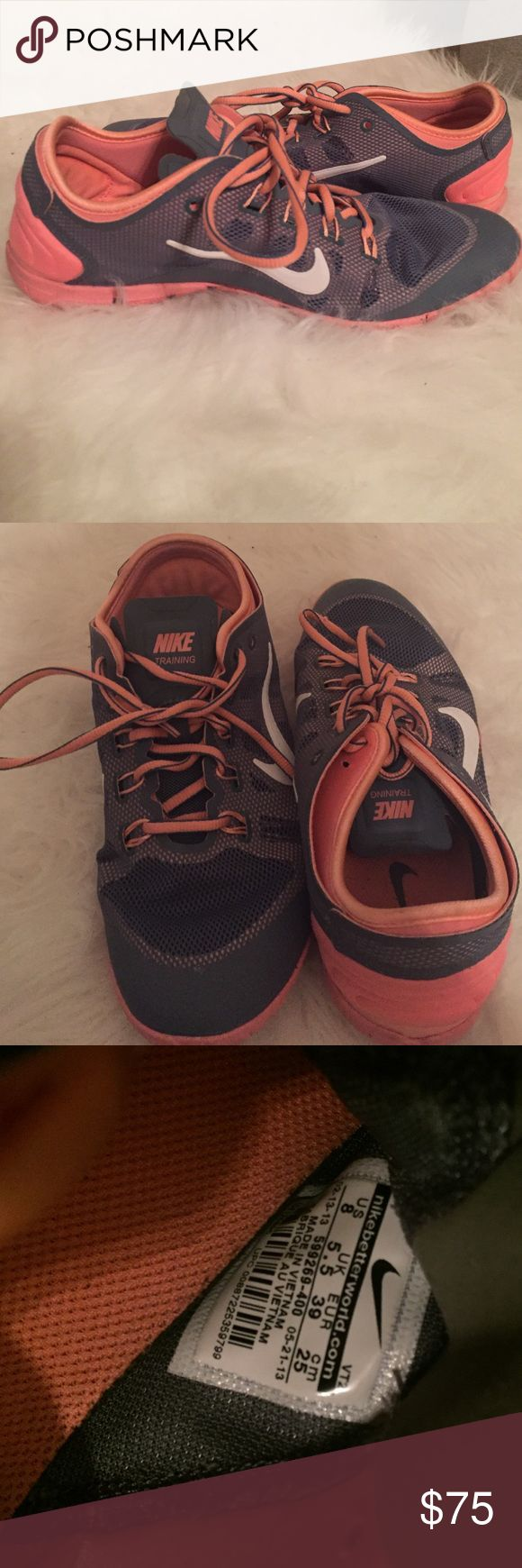 Nike training shoes Gray and pink nike training shoes. Great for weight training. Worn once. Nike Shoes Athletic Shoes