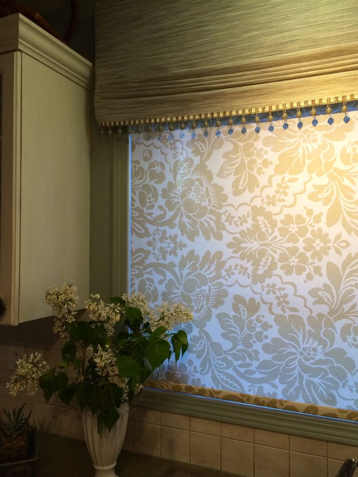 Our client didn't just want a simple blind in the kitchen. This beautiful patterned roller shade compliments the fabric valance. Learn more about the many different window covering options available on our website: www.normandeauwc.com