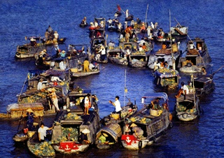 Floating Market-Hau Giang: Farmers from the region bring their goods, fruits and vegetables mainly, to the markets and sell them to local dealers. This is what Mekong Delta is famous for.
