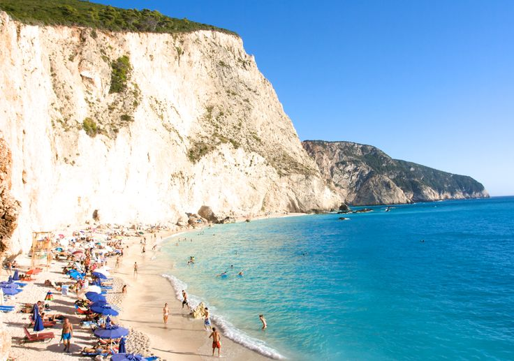 Porto Katsiki Beach, Lefkas: This beach, at the foot of an enormous white cliff that turns orange with the sunset has been voted one of the six best in the entire Mediterranean.