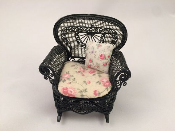 Black Miniature Victorian Rocking Chair. Comes with seat cushion and throw pillow.
