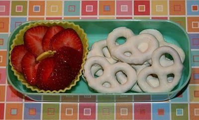 Simple valentine day snack ~ sliced strawberries and yogurt covered pretzels