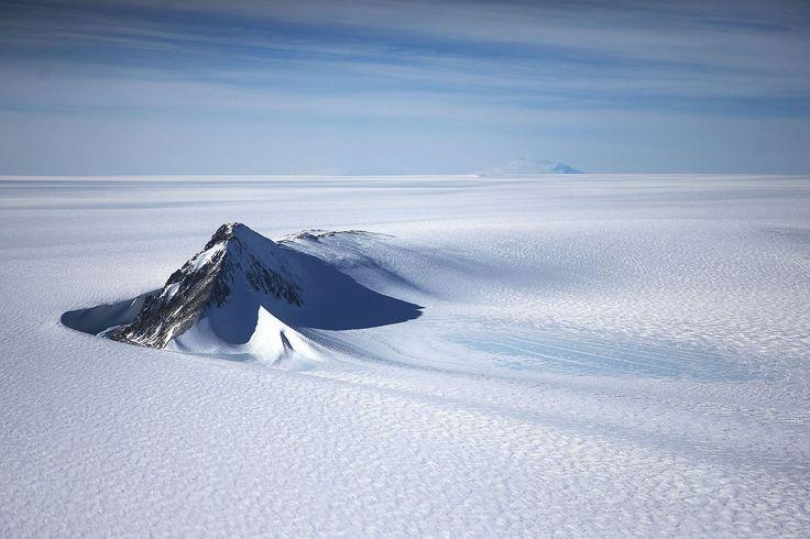 Nunatak, windscoop and ice sheet, West Antarctica