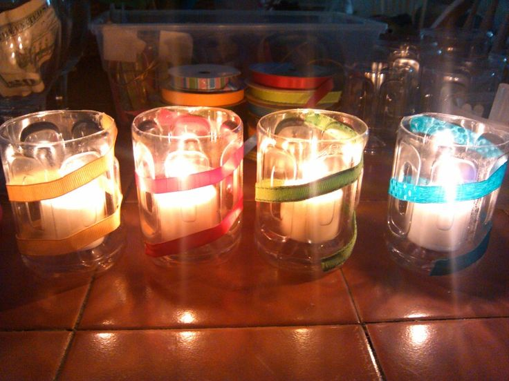 Votitves!! Recycled gatorade bottles, assorted ribbon and votive candles!
