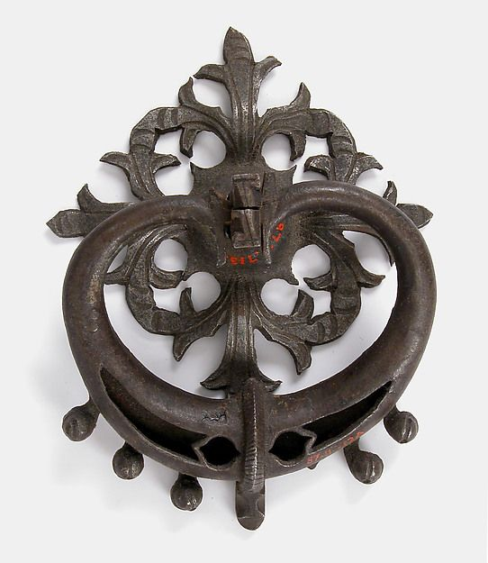 Door Handle Date: 15th century Culture: German Medium: Iron Dimensions: Overall (as if installed): 4 1/2 x 3 1/2 x 1 1/4 in. (11.5 x 8.9 x 3.1 cm) Bail-a: 4 5/16 x 3 5/16 x 9/16 in. (11 x 8.4 x 1.5 cm) Plate-b: 3 5/8 x 3 1/2 x 9/16 in. (9.2 x 8.9 x 1.5 cm)