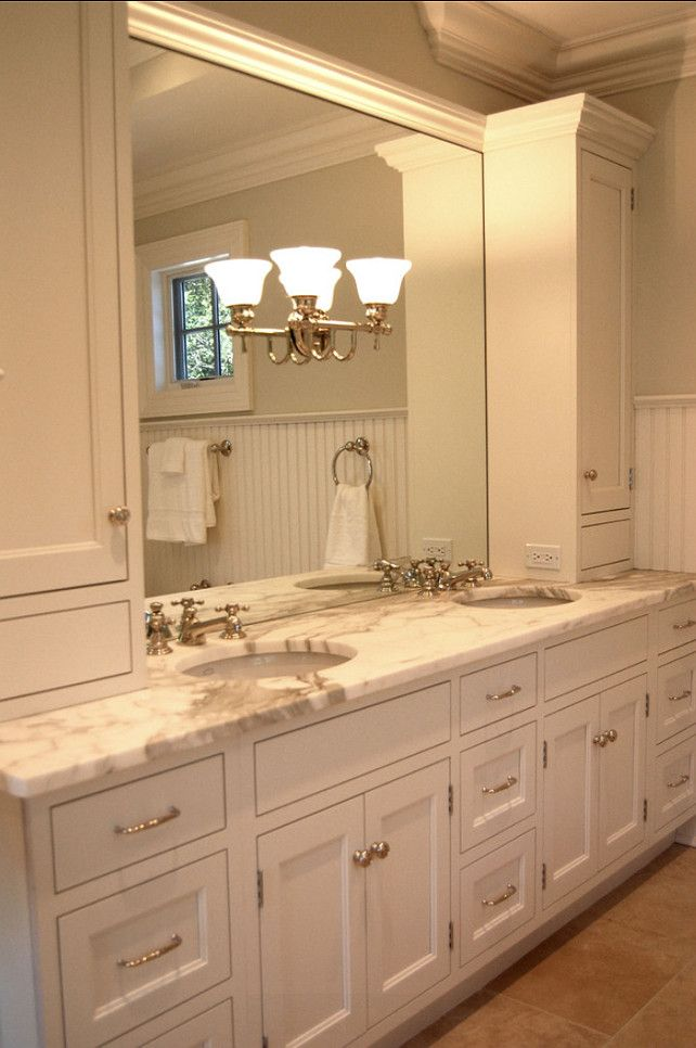 "Bathroom Vanity Ideas. This custom vanity has has two 15"" drawer units on either side. In addition, there are wide tall upper cabinets for toiletry storage. The faux drawers at bottoms hide electrical boxes. Calcatta gold marble countertops are stunning.  CLICK ON PIN AND LEARN HOW TO MAP PINS WITH YOUR ARCHITECTURE BUSINESS"