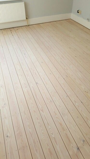 Brighton floor sanding, white wash stained pine by Btown Flooring.