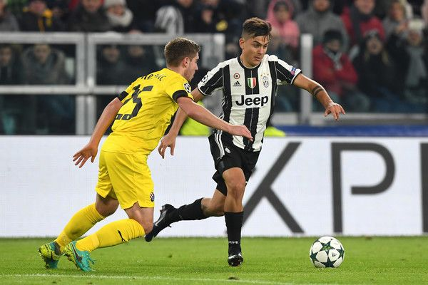 Paulo Dybala (R) of Juventus is challenged by Bojan Knezevic of GNK Dinamo Zagreb during the UEFA Champions League Group H match between Juventus and GNK Dinamo Zagreb at Juventus Stadium on December 7, 2016 in Turin.