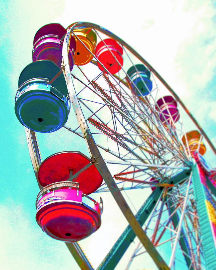 High in the sky, a colorful Ferris Wheel~