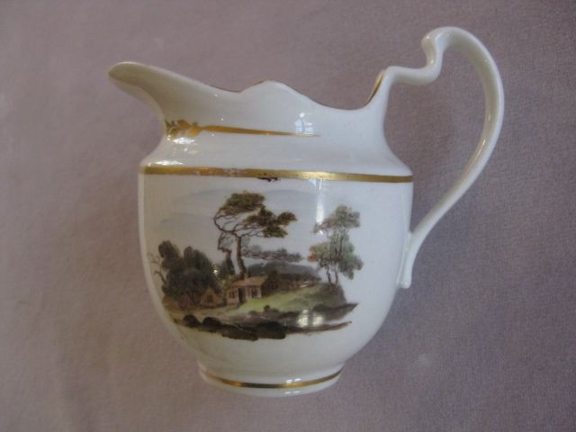 """A Pinxton porcelain creamer painted to either sides with a bridge and river in landscape and houses in a rural landscape. Unmarked Pattern 218 Circa 1805 Height  4 3/4 """""""